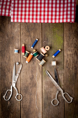 Vintage Background with sewing tools and colored tape. Sewing