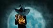 Leinwanddruck Bild - Mystery witch opening Halloween carved pumpkin