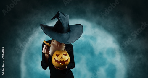 Leinwanddruck Bild Mystery witch opening Halloween carved pumpkin