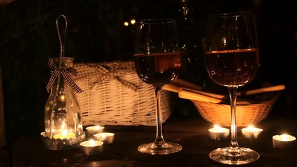 Romantic table with a lot of candles, two glasses wine.