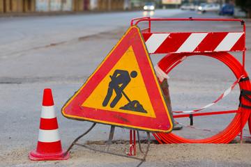 Road sign, man at work