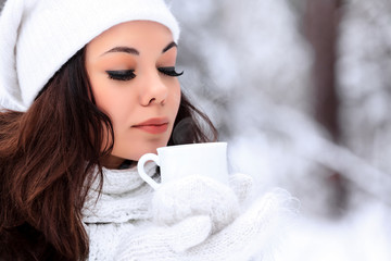 woman with a cup of hot tea posing outdoors