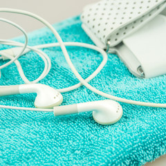 headphones, mp3 and turquise towel symbols of modern lifestyle
