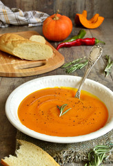 Pumpkin creamy soup with rosemary.