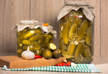 pickled gherkins in glass jars