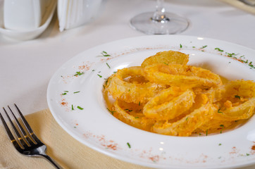 Bowl of Onion Rings at Fancy Table Setting