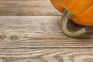 weathered wood with pumpkin