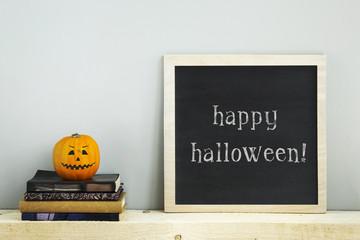 chalkboard frame  with books  pumpkins HAPPY HALLOWEEN