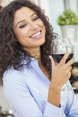Hispanic Woman Smiling Drinking Red Wine
