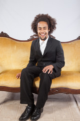 Handsome Black man sitting and smiling