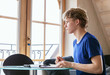 Diligent student doing homework using Tablet