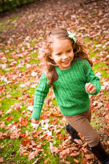 Cute baby girl on the autumn forest