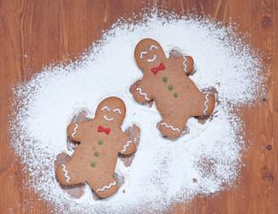 gingerbread man making a snow angel