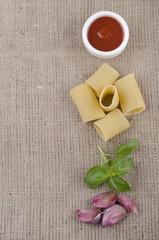paccheri pasta on brown jute