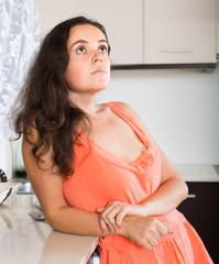 Portrait of sad woman at kitchen