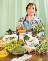 elderly woman with medicinal herbs