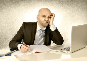 hispanic businessman bored with computer at work