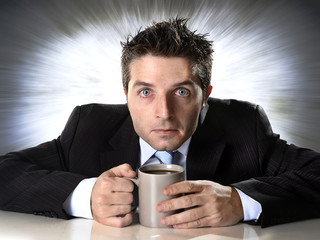 addict businessman holding coffee cup in caffeine addiction