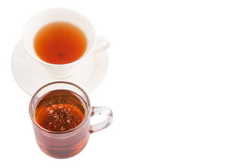 A cup of tea and a jar of honey over white background