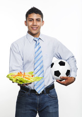 Business ma with soccer ball and fresh salad