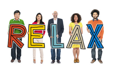 Diverse Group of People Holding Text Relax
