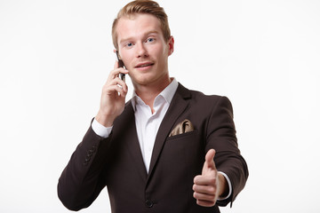 businessman in glasses with phone shows thumb