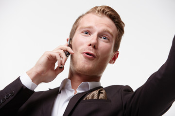 businessman in glasses with a telephone waving