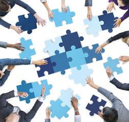 Business People Piecing Puzzle Pieces