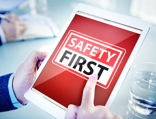 Hands Holding Digital Tablet Safety First