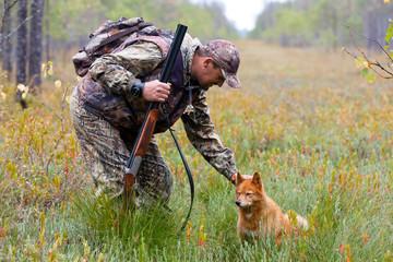 hunter stroking the dog