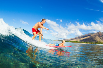 Father and Son Surfing, Riding Wave Together