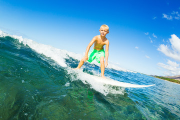 Boy Surfing Ocean Wave