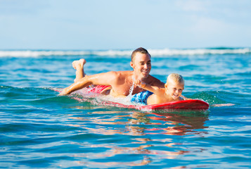 Father and Son Going Surfing