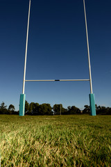 Goal Posts set against a blue sky.