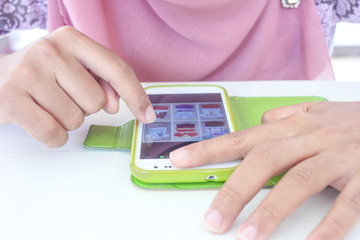 SONGKHLA, THAILAND - SEP 22, 2014: Muslim woman using mobile sma