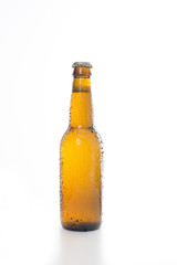 Brown beer bottled isolated on a white background.