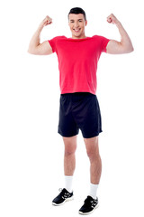 Smiling athlete raising his fists in excitement
