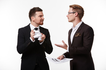 two businessmen arguing