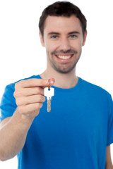 Young man in holding key