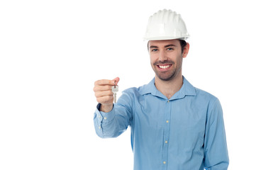 Smiling engineer holding key