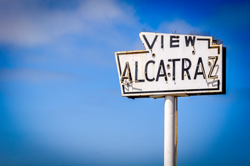 broken old and abandoned sea-side neon sign reads View Alcatraz