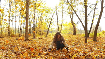 Brunette girl in autumn park