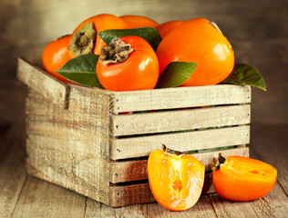 fresh persimmons with leafs