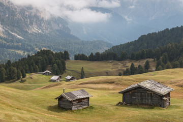 timbered barns in Dolomites