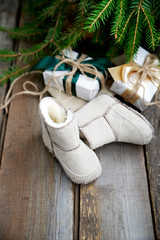 Christmas wrapped gifts and baby booties