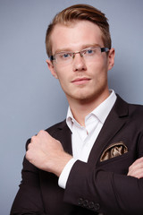 businessman in glasses in a suit smiling