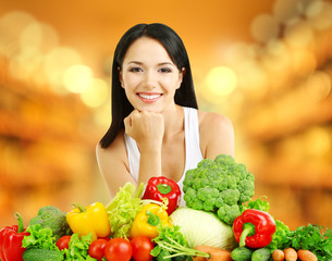 Shopping concept. Girl with vegetables on shop background