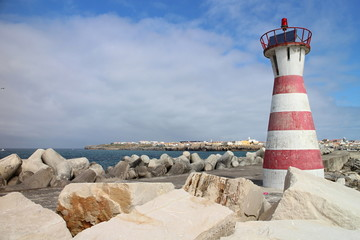 Red and white striped lighthouse in Peniche, Portugal