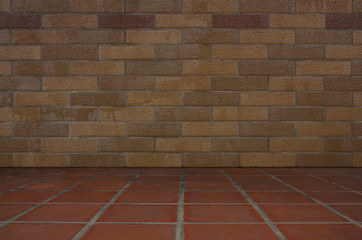 Brown brick walls and red tile floors.