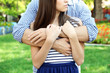 Embrace a loving couple outdoors